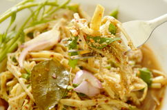 Spicy slice bamboo shoot salad in Thai northeastern style scooping on fork Stock Photography