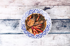 Spicy sliced catfish curry in coconut milk with Morinda citrifol Royalty Free Stock Photos