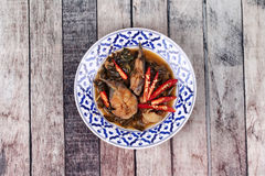 Spicy sliced catfish curry in coconut milk with Morinda citrifol Royalty Free Stock Photography