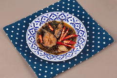 Spicy sliced catfish curry in coconut milk with Morinda citrifol Royalty Free Stock Images