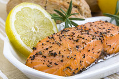 Spicy smoked salmon with lemon and bread bun Stock Photos