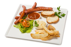 Spicy smoked sausage with cheese and fry potatoes in a pan Royalty Free Stock Image