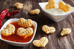 Spicy snacks  in the form of hearts Stock Photography