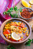 Spicy soup with chicken and chickpeas. In wooden bowl Royalty Free Stock Photo