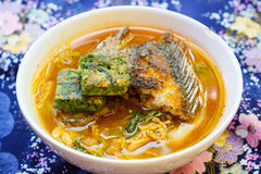 Spicy and soup curry with fish and vegetable omelet. Royalty Free Stock Images