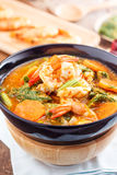 Spicy and Soup Curry with Shrimp and Vegetable Omelet Stock Photo