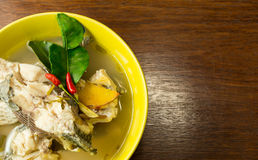 Spicy soup with fish (tomyum). Thai style Spicy soup with fish (tomyum Royalty Free Stock Image
