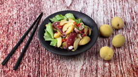 Spicy sour Chinese sausage salad with Peach honey - compote . Stock Photos