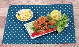 Spicy sour fried chicken salad (Yum Kai Zap in Thai). As spicy chicken salad,chili,tomato,red onion,roasted rice,dried chili ,Chinese cabbage,lettuce,peppermint Stock Photos
