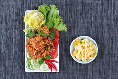 Spicy sour fried chicken salad (Yum Kai Zap in Thai) with side dish. Spicy sour fried chicken salad (Yum Kai Zap in Thai) as spicy chicken salad,chili,tomato Royalty Free Stock Photo