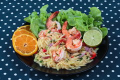 Spicy sour minced green mango salad with shrimp. Stock Photos