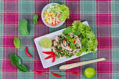 Spicy and sour mixed herb salad with meat and side dish. Royalty Free Stock Images