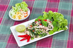 Spicy and sour mixed herb salad with meat and side dish. Side view. Stock Photography
