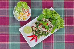 Spicy and sour mixed herb salad with meat and side dish. Top view. Royalty Free Stock Photos