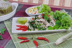 Spicy and sour mixed herb salad with meat and side dish.  Top view Stock Photography