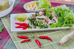 Spicy and sour mixed herb salad with pork and chicken  with side dish as mini vegetable salad and streamed gourd  wrap vermicelli Stock Image