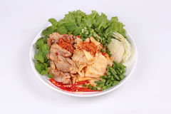 Spicy sour mixed vegetable salad with chicken and bamboo shoots. Stock Photos