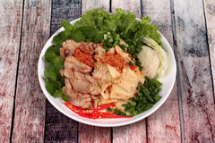 Spicy sour mixed vegetable salad with chicken and bamboo shoots. Stock Image
