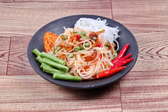 Spicy and sour mixed vegetable salad with rice noodle served . Royalty Free Stock Photos