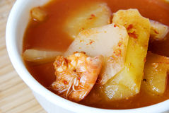 Spicy and sour soup with shrimp and green papaya. Closeup of Thai curry Spicy and sour soup with shrimp and green papaya royalty free stock photo
