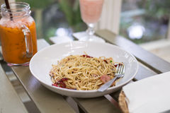 Spicy spaghetti  with bacon, garlic and dried chili Stock Photography