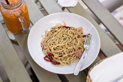 Spicy spaghetti  with bacon, garlic and dried chili Royalty Free Stock Photos