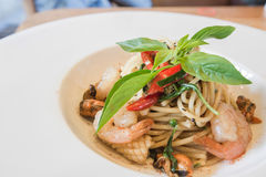 Spicy spaghetti seafood in white dish Royalty Free Stock Images