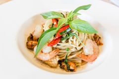 Spicy spaghetti seafood in white dish Royalty Free Stock Photo