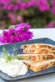 Spicy Spam Quesadilla. Quesadilla with spam, jalapenos and cheese with dill yogurt sauce Royalty Free Stock Photography