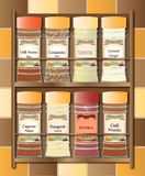 Spicy Spice Rack. A small spice rack with hot spices on a kitchen tile background Royalty Free Stock Image