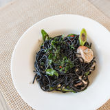 Spicy squid ink spaghetti with green mussel and shrimp Stock Image