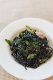 Spicy squid ink spaghetti with green mussel and shrimp Stock Photos
