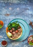 Spicy sriracha meatballs with buckwheat soba noodles Royalty Free Stock Photos