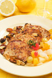 Spicy steak with tropical fruit and roasted nuts Stock Photos