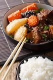 Spicy stewed ribs with vegetables, sesame and rice garnish close stock photos