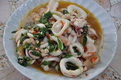 Spicy stir fried calamari with basil leaves Stock Images