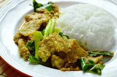 Spicy stir fried Chinese kale with minced pork and belly in curry on rice Stock Photo