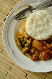 Spicy stir fried fat pork and yard long bean curry eat couple with rice. On dish stock images