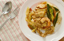 Spicy stir fried shrimp and pork with sweet long chili on rice Royalty Free Stock Photos