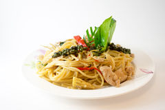 Spicy stir fried Spaghetti or thai Pad Kee Mao with chicken. On isolate white background Royalty Free Stock Image