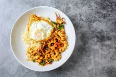 Spicy stir fried squid with basil leaves and chili, Sunny side up egg stock images