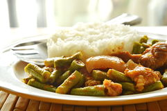 Spicy stir fried yard long bean and fat pork curry eat couple with rice. On dish stock photography