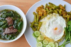 Spicy stir fried yard long bean with fat pork curry topping egg and boiled pork blood soup Stock Image