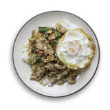 Spicy stir-fry beef with the holy basil topping with fried egg. Top view Royalty Free Stock Photo