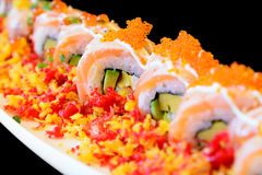 Spicy sushi salmon roll Stock Photo
