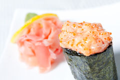 Spicy Sushi with salmon and tobiko caviar Royalty Free Stock Image