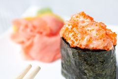 Spicy Sushi with salmon, tobiko caviar and nori Stock Image
