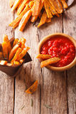 Spicy sweet potato fries with rosemary and herbs and ketchup clo Stock Photos
