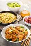 Spicy sweet and sour chicken with rice and cabbage. Spicy sweet and sour general tso chicken with fried rice and purple cabbage Stock Images