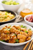 Spicy sweet and sour chicken with rice and cabbage. Spicy sweet and sour general tso chicken with fried rice and purple cabbage Royalty Free Stock Images